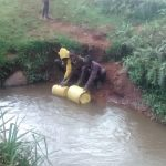 The Water Project: Mwanzo Primary School -  Students Fetching Water At A Flowing River