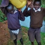 The Water Project: Mwanzo Primary School -  Carrying Water