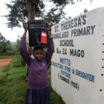 The Water Project: Shamalago Primary School -  Carrying Water