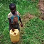 The Water Project: Ulagai Community, Rose Obare Spring -  Little Boy On His Way To The Spring