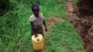 The Water Project:  Little Boy On His Way To The Spring