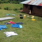 The Water Project: Wasenje Community, Margaret Jumba Spring -  Clothes Drying At Neighboring Home