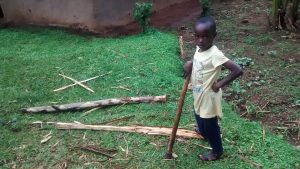 The Water Project:  Girl Splitting Firewood