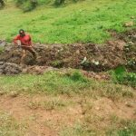 The Water Project: Kakubudu Community, Fred Lagueni Spring -  Digging Drainage