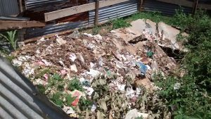 The Water Project:  Collapsed Latrine Turned Into Garbage Site