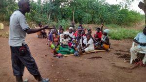 The Water Project:  Simon Mugume Facilitating The Meeting