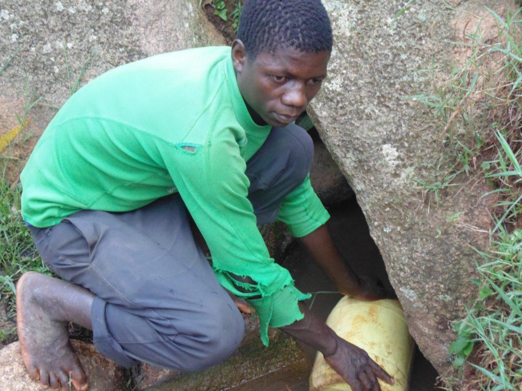 The Water Project : 3-kenya18093-joseph-fetching-water