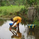 The Water Project: Sanya Community -  Fetching Swamp Water