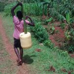 The Water Project: Ivulugulu Community -  Carrying Water