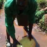 The Water Project: Ulagai Community -  Fetching Water