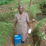 The Water Project: Shiru Community, Sammy Alumola Spring -  Mrs Alumola