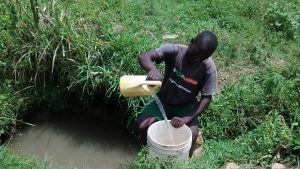 The Water Project:  Vincent Fetching Water