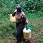 The Water Project: Emwanya Community, Josam Kutsuru Spring -  Woman Heading To The Spring