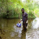 The Water Project: Kipolo Community -  Wading To Fetch Water