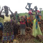 The Water Project: Ejinga-Ayikoru Community -  People Bringing Stones To Help The Artisan
