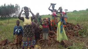 The Water Project:  People Bringing Stones To Help The Artisan
