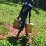 The Water Project: Ulagai Community, Aduda Spring -  Carrying Water