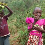 The Water Project: Shiru Community, Sammy Alumola Spring -  Children Eating Guavas