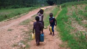 The Water Project:  Children Carrying Water