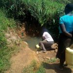 The Water Project: Ikonyero Community, Jesse Spring -  Fetching Water