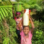 The Water Project: Kipolo Community -  Carrying Water