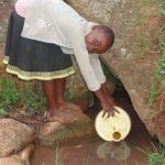 The Water Project: Chandolo Community -  Alice Fetching Water