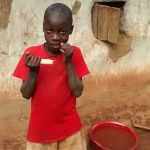 The Water Project: Elukani Community -  Child Chewing Sugarcane To Curb Hunger
