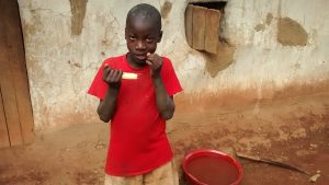 The Water Project:  Child Chewing Sugarcane To Curb Hunger