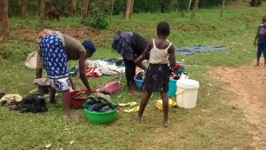The Water Project:  Doing Laundry By The Spring
