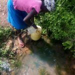 The Water Project: Musango Community D -  Lilian Fetching Water