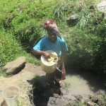 The Water Project: Futsi Fuvili Community, Simeon Shimaka Spring -  Carrying Water