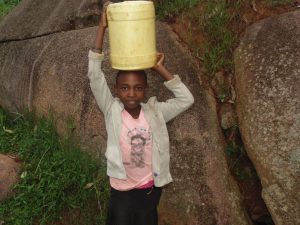 The Water Project:  Alice Carrying Water