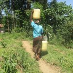 The Water Project: Futsi Fuvili Community C -  Carrying Water