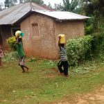 The Water Project: Emwanya Community, Josam Kutsuru Spring -  Carrying Water