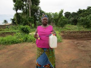 The Water Project:  Woman With Her New Hand Washing Station