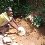 The Water Project: Jivovoli Community -  Fetching Water