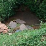 The Water Project: Jivovoli Community, Gideon Asonga Spring -  Current Water Source