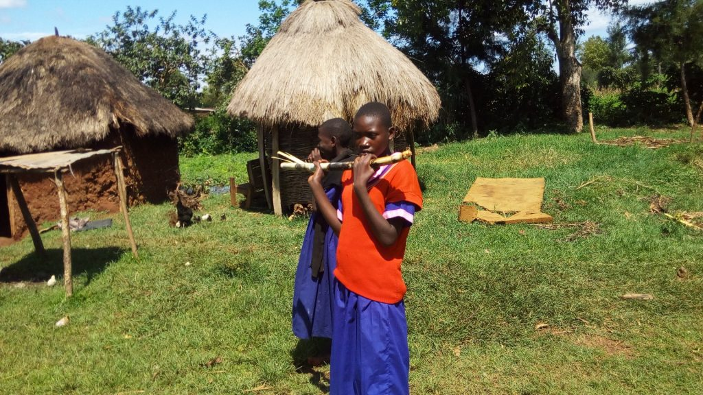 The Water Project : 1-kenya18120-students-snacking-on-sugarcane