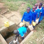 The Water Project: Eshiamboko Primary School -  Fetching Water