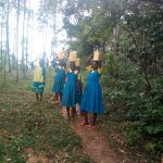 The Water Project: Lugango Primary School -  Carrying Water