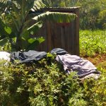 The Water Project: Jivovoli Community, Gideon Asonga Spring -  Latrine And Clothes Drying