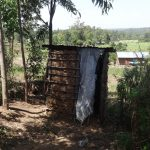 The Water Project: Ingavira Community, Laban Mwanzo Spring -  Latrine