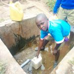 The Water Project: Eshiamboko Primary School -  Willian Oduor Fetching Water At A Community Spring
