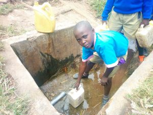 The Water Project:  Willian Oduor Fetching Water At A Community Spring