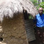 The Water Project: Masera Community -  Village Elder Stands By His Latrine