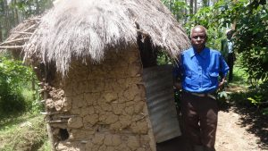 The Water Project:  Village Elder Stands By His Latrine