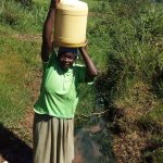 The Water Project: Luvambo Community A -  Carrying Water