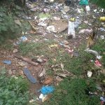 The Water Project: Jivovoli Community -  Garbage Behind A Home