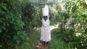 The Water Project:  Woman Coming Back From The Spring