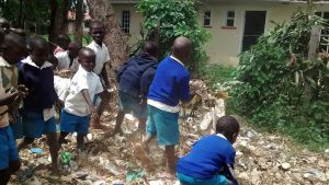 The Water Project:  Students Picking Through The Garbage